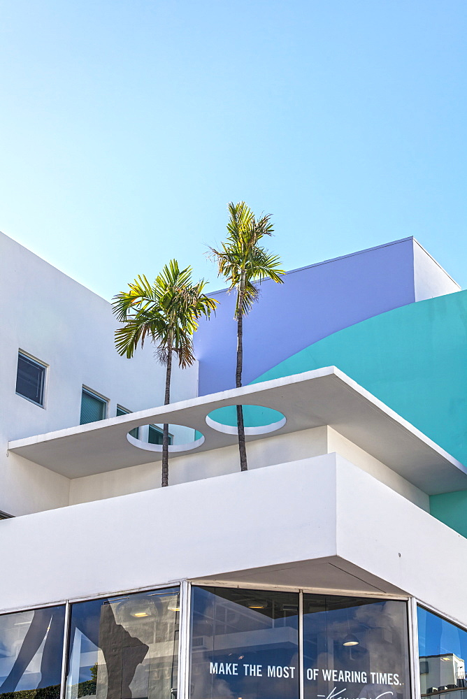 Modern architecture with palm trees on Collins Avenue, Art Deco District, South Beach, Miami, Florida, USA