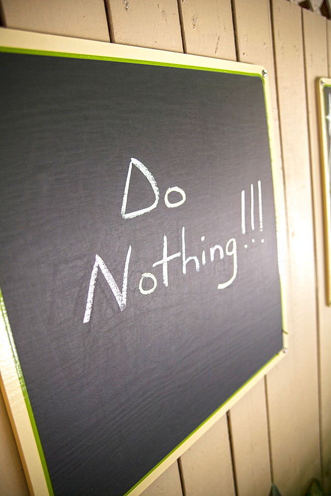 Blackboard with relaxing slogan of the day, Do Nothing, Little Palm Island Resort, Florida Keys, USA - 1113-98023
