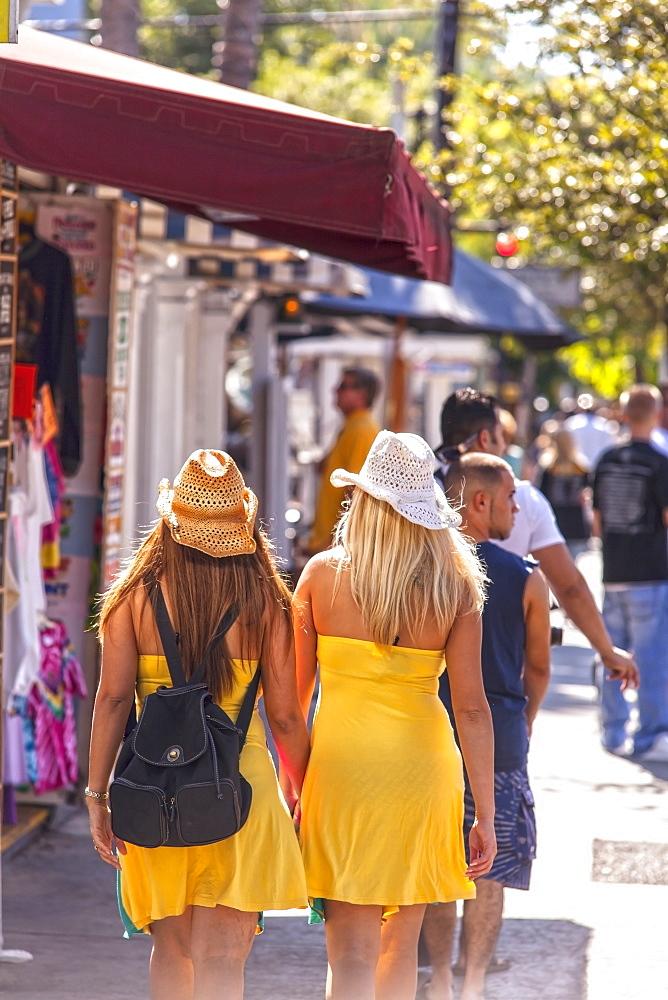Two young women shopping on Duval Street, Key West, Florida Keys, Florida, USA