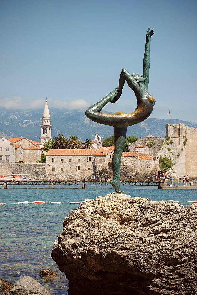 Sculpture of a nude female acrobat in front of old town of Budva, Stari Grad, Adriatic coastline, Montenegro, Western Balkan, Europe
