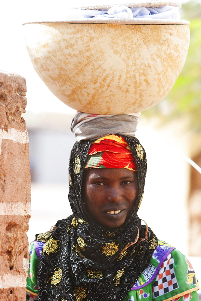 Woman carrying a calabash on her head, Bamako-Djenne Road, Mali