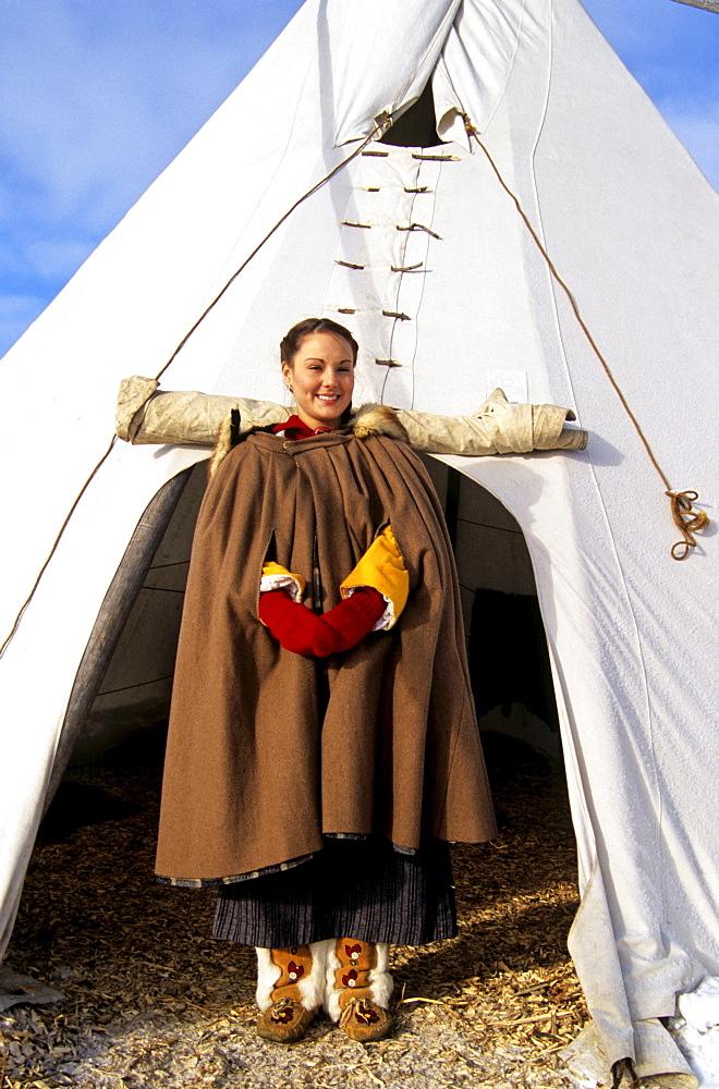 Girl in Metis Dress in front of Teepee, Festival du Voyageur, Winnipeg, Manitoba
