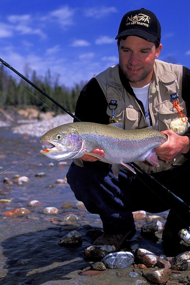 Man with Steelhead Fish along Lake Superior, Northern Ontario