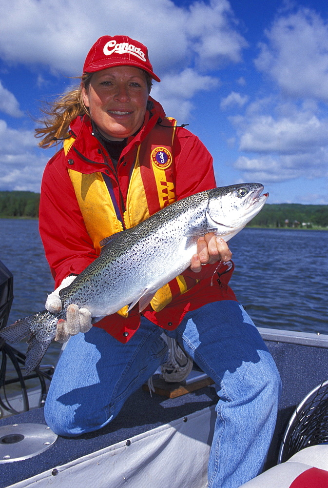 Woman with a Rainbow Trout, Northern Ontario