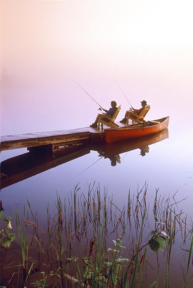 Couple Fishing off Dock, Winnipeg River, Pinawa, Manitoba