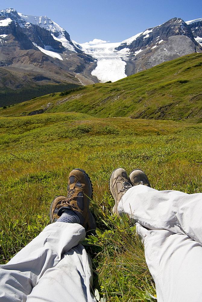 View of Hikers Legs Relaxing, Jasper National Park, Alberta