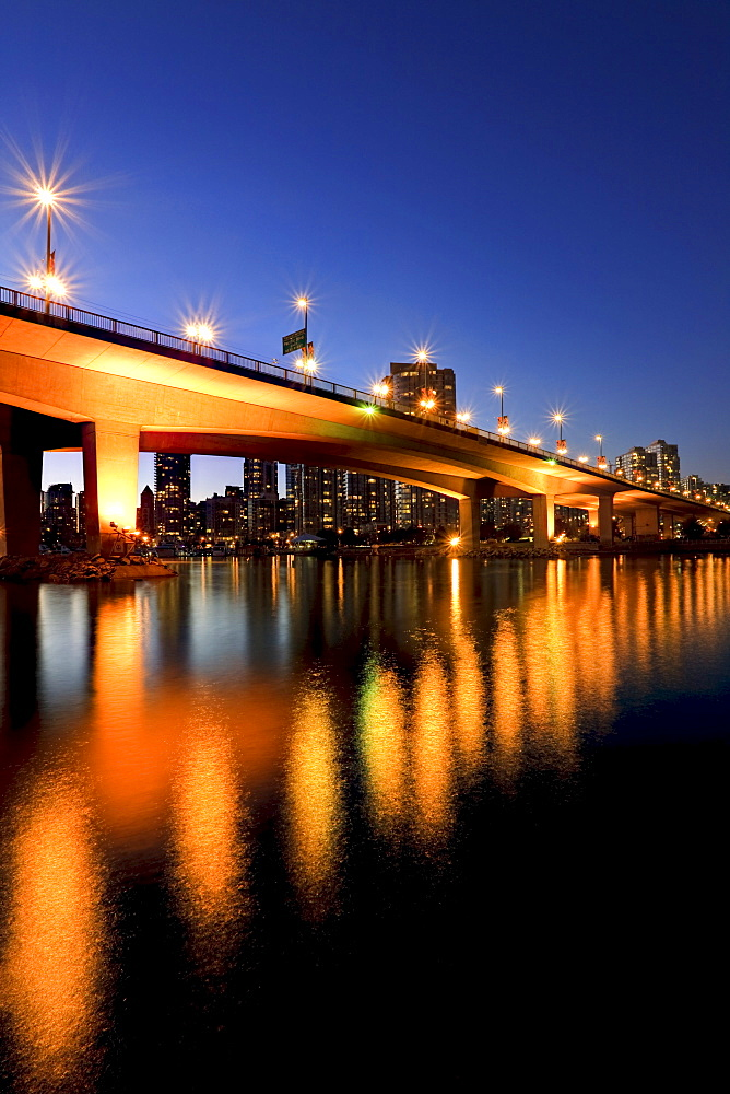 Artist's Choice: View under Cambie Street Bridge from False Creek to condominiums of Yaletown, Vancouver, British Columbia