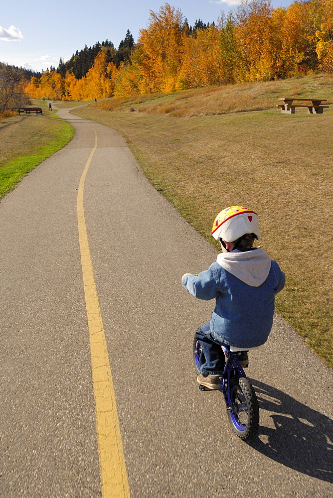 Boy Wearing a Bike Helmet and Biking Recreation Path, Edmonton River Valley, Alberta