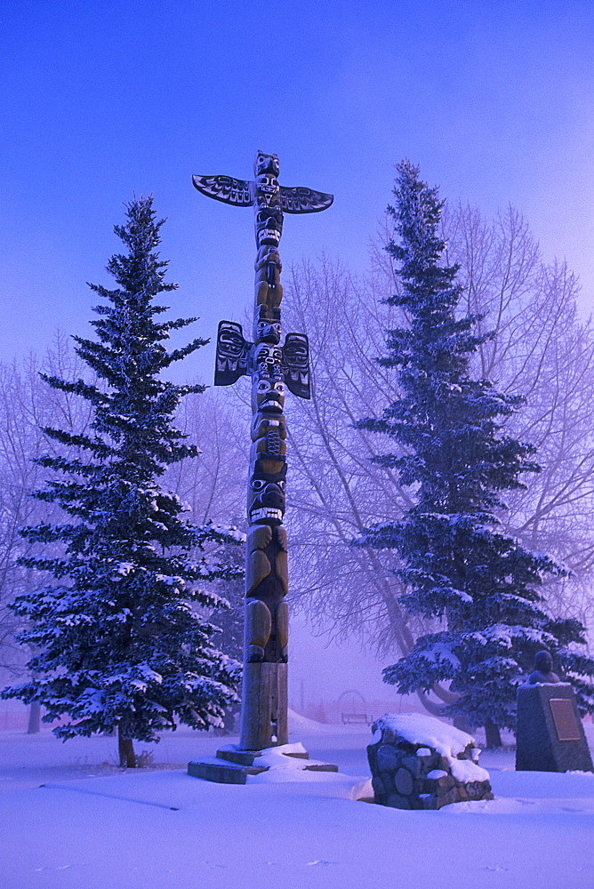 Totem Pole in Winter with Pine Trees, Whitehorse, Yukon