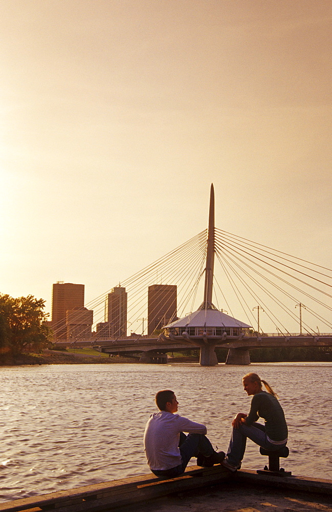 Teens Relaxing on a Dock with Red River in the background, Winnipeg, Manitoba