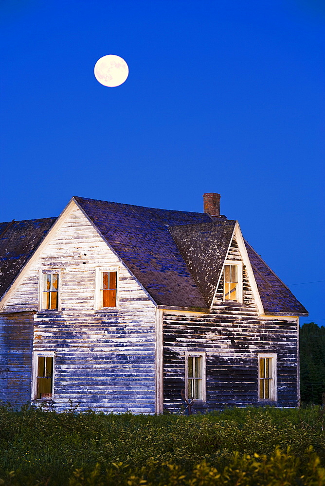 Abandoned house and moon at dusk, Perce, Gaspesie, Quebec