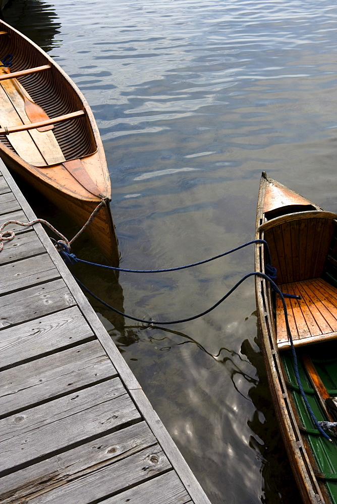 Canoes tired to a dock, Lake Joseph, Muskoka, Ontario