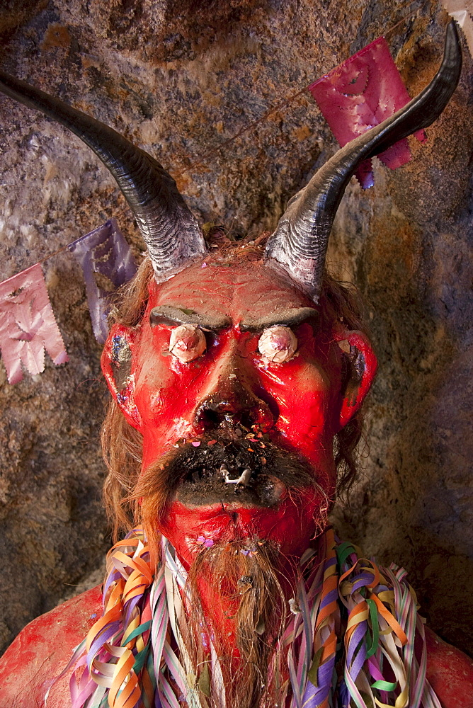Ceramic figure of el Tío or Supai , a creature with horns, gleaming eyes and a big penis, that in fact is not really satanic. It was introduced by the Spaniards in the 16th Century to the mines of Potosí. According to tradition, el Tío (The Uncle) rules over the mines of Cerro Rico, simultaneously offering protection and destruction. Over 500 chambers with statues to honour him have been constructed in Cerro Rico, so miners can leave offerings of tobacco, liquor and coca leaves to invoke his goodwill and protection., Potosi Department, Bolivia