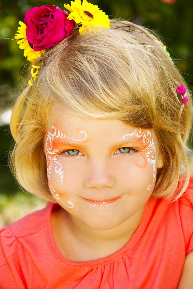 Hawaii, Young girl wearing facepaint.
