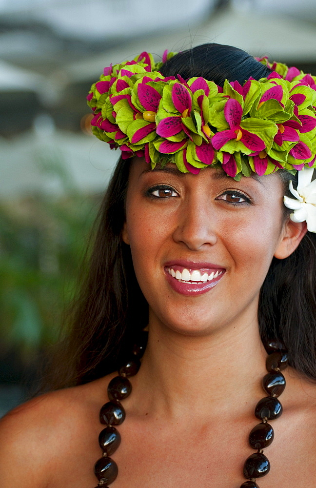 French Polynesia, Tahiti, Bora Bora, A local woman smiles in her floral headpiece.