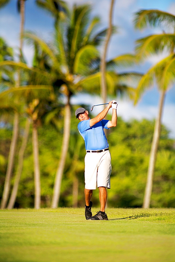 Hawaii, Maui, Maui Country Club, Man enjoys a day of golf during his vacation.