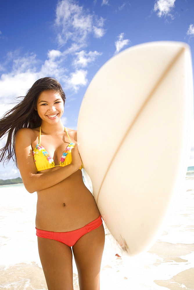 Hawaii, Oahu, Surfer girl enjoying a day out.