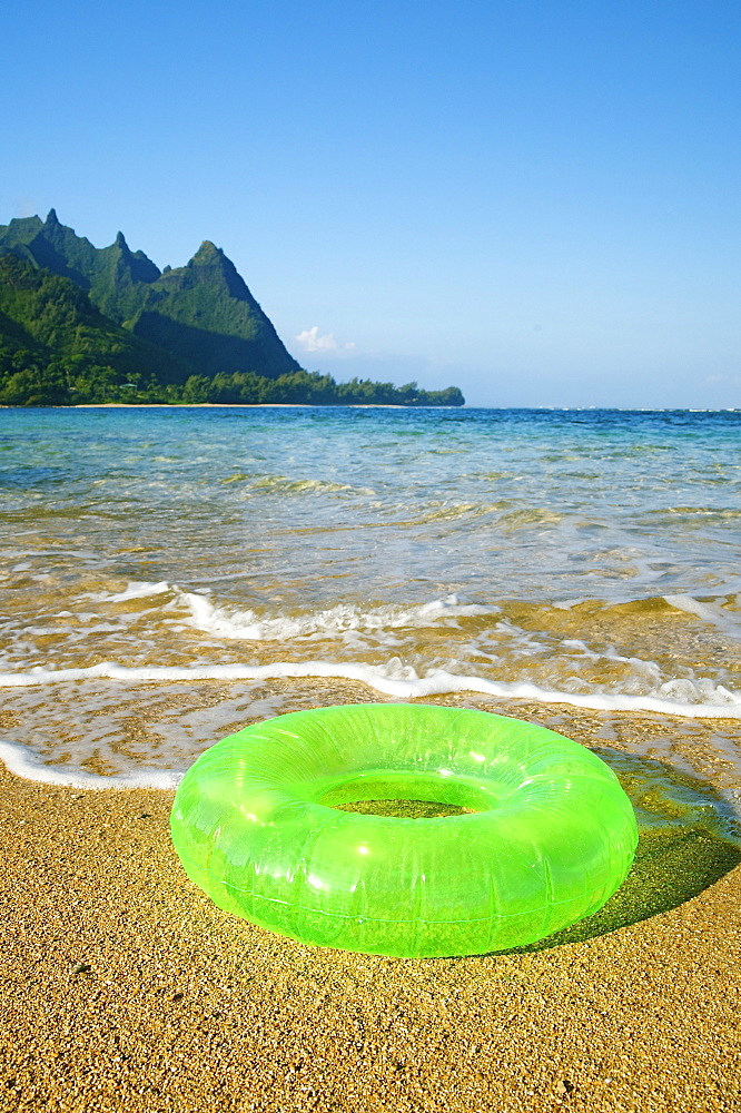 Hawaii, Kauai, Tunnels beach, Green innertube on the beach.