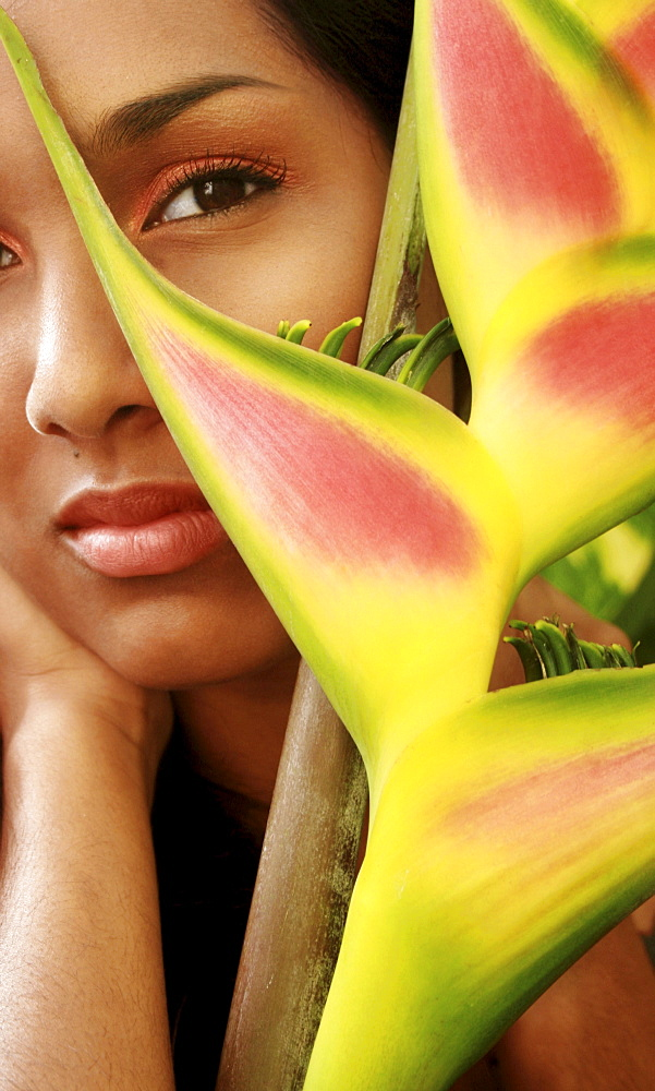 Hawaii, Oahu, Headshot portrait of Beautiful Gorgeous Young Girl with Heliconia ginger flower.
