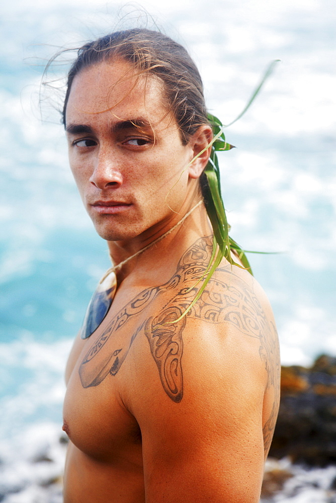 Hawaii, Oahu, Makapuu, Headshot of Polynesian man with traditional tattoos.
