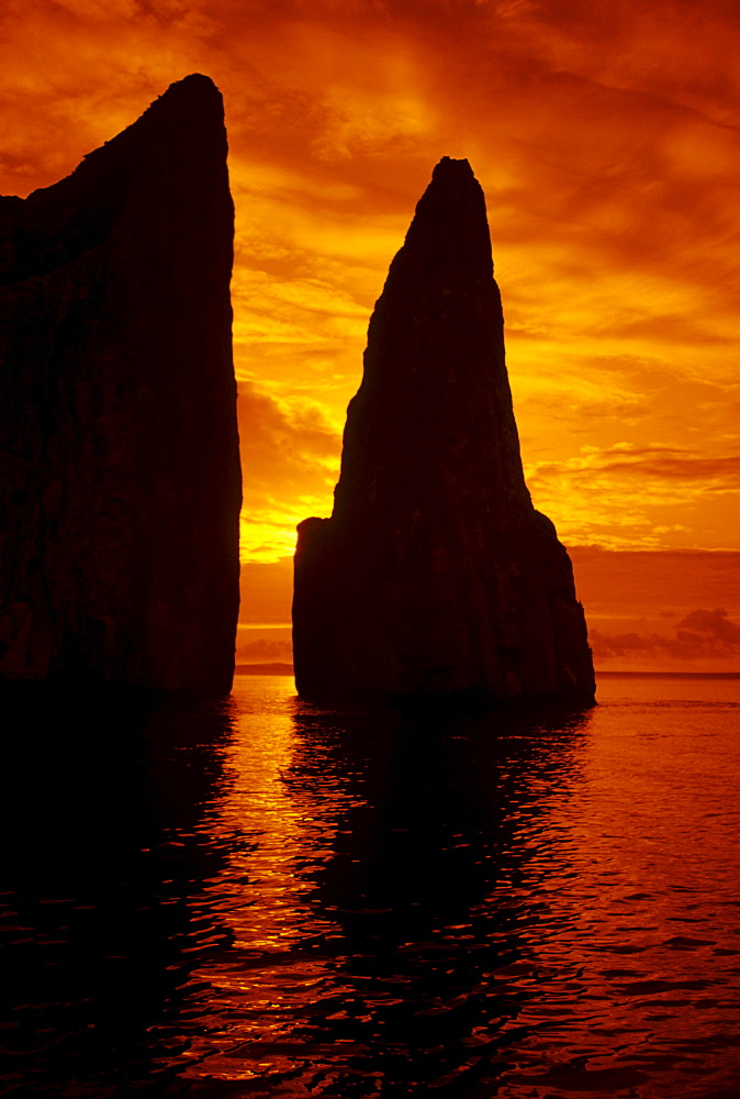 Galapagos, Orange sunrise over Kicker Rock.