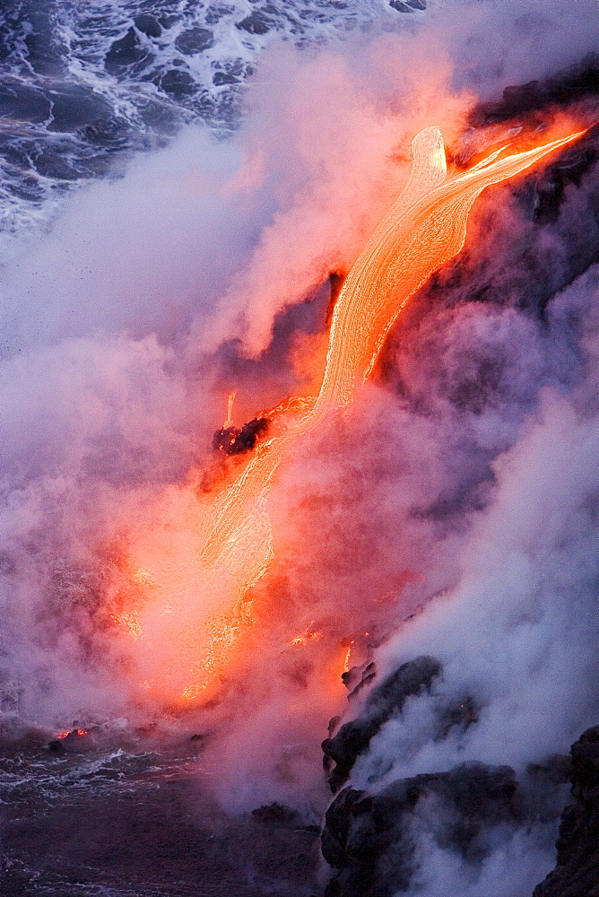 Hawaii, Big Island, near Kalapana, Pahoehoe lava flowing from Kilauea into steaming Pacific Ocean.