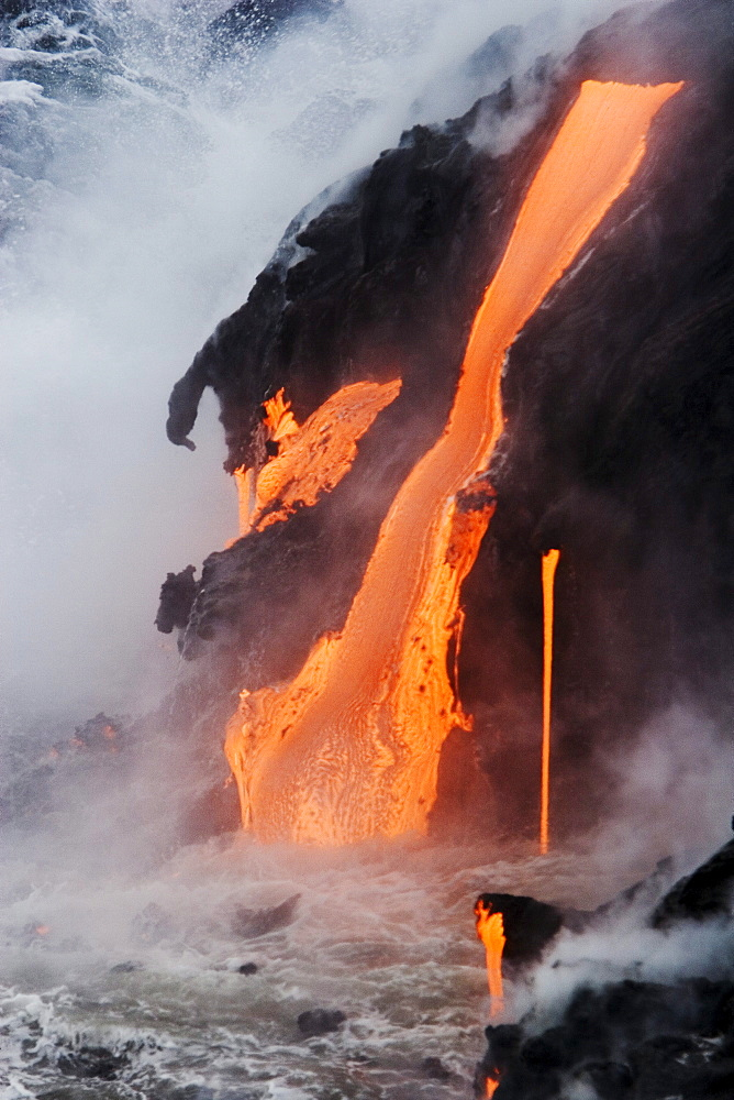 Hawaii, Big Island, near Kalapana, Pahoehoe lava flowing from Kilauea into Pacific Ocean, Steam rising.