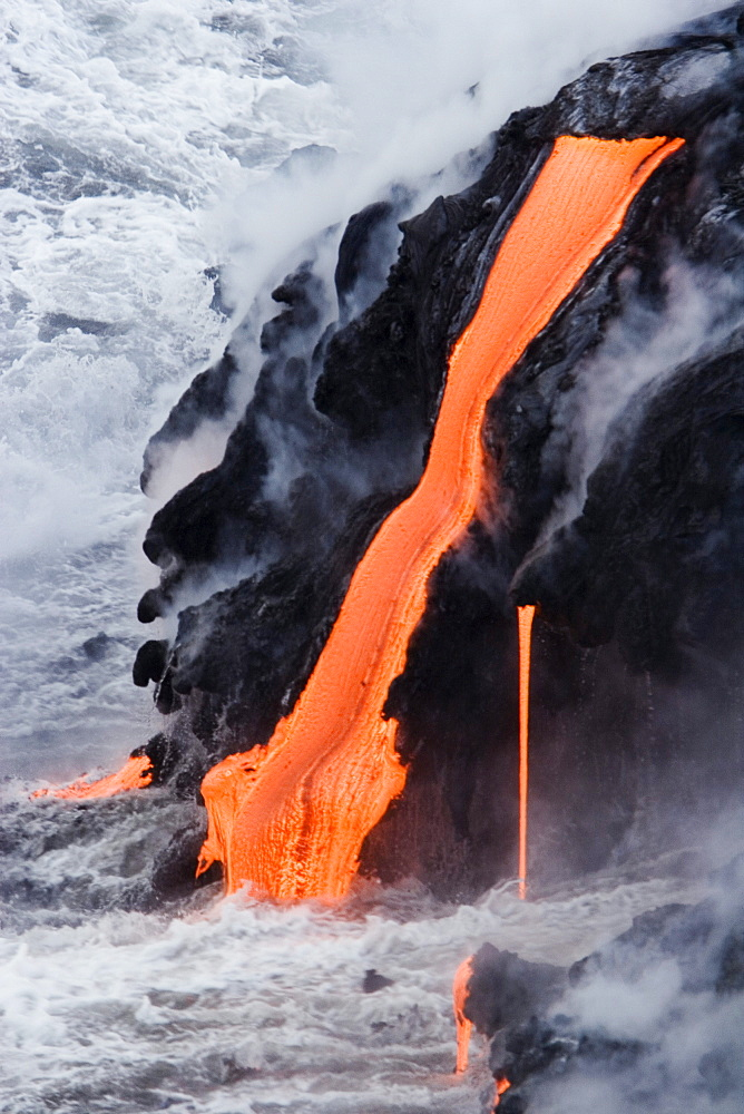 Hawaii, Big Island, near Kalapana, Pahoehoe lava flowing from Kilauea into Pacific Ocean.