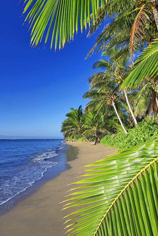 Hawaii, Molokai, A small deserted beach on the south shore, Lanai in the background.