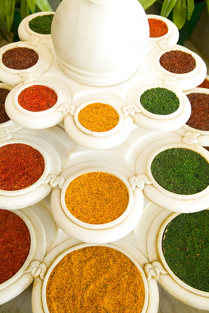 India, Agra, Abstract colorful bowls of spices in vases from above.