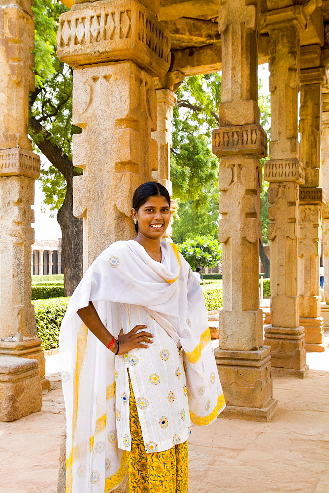 India, New Delhi, Qutub Minar Complex, Beautiful woman in colorful sari.