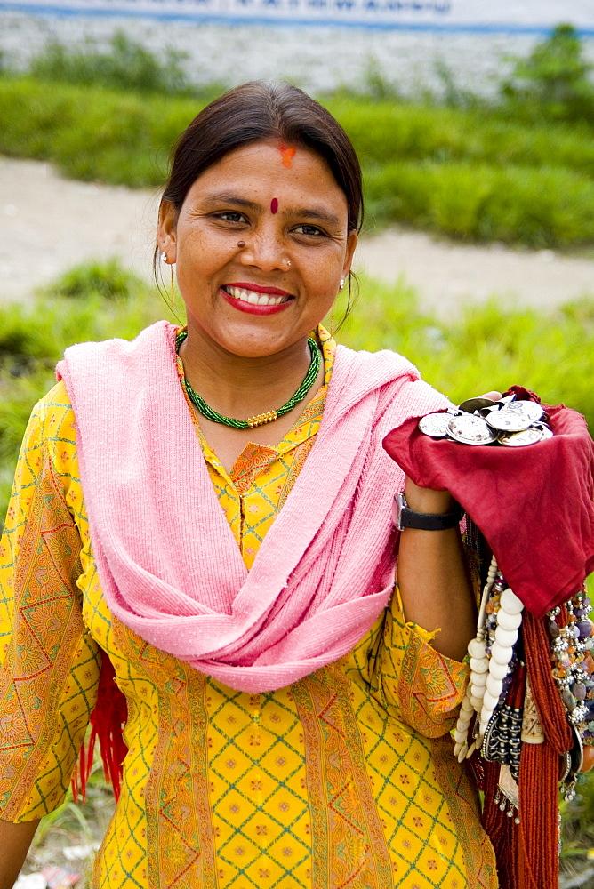 India, New Delhi, Beautiful woman selling items at Laxmi Narayan Temple near huge Chartarpur Road Temple.