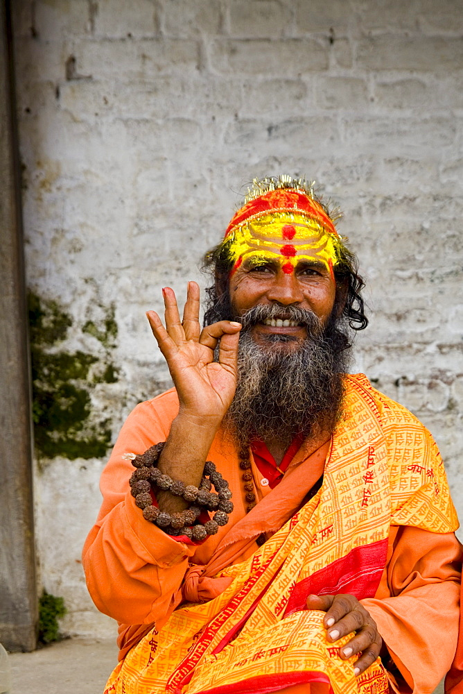 Nepal, Kathmandu,  religious man at Pashupatinath holy Hindu place on Bagmati River, painted and colorfully dressed.