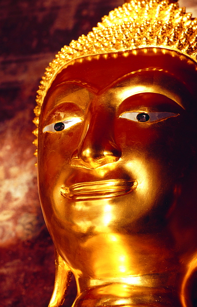 Thailand, Bangkok, Wat Suthat, closeup detail of golden Buddha statue, memorial for deceased