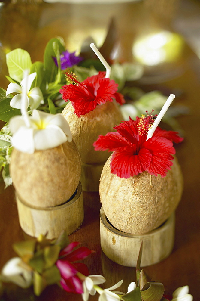 French Polynesia, Bora Bora, Close-up of a refreshing tropical cocktails in coconut cups