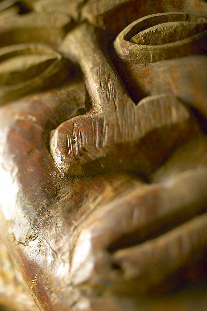 French Polynesia, Tahiti, Bora Bora, Close-up of the carved face of a wooden statue