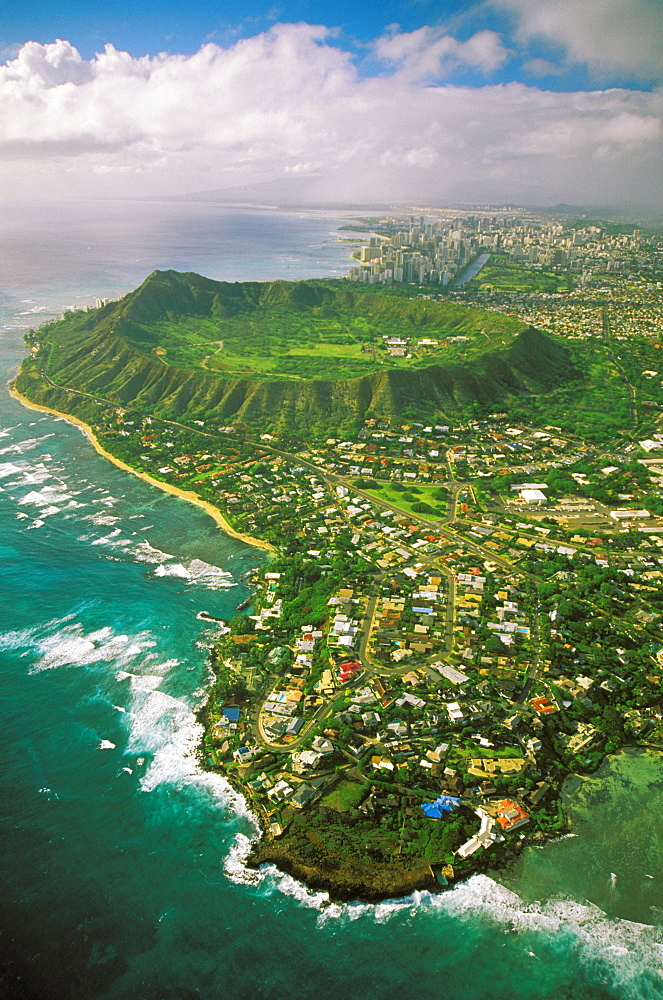 Hawaii, Oahu, Coastline aerial of Kahala homes and Diamond Head Crater, Waikiki hotels background