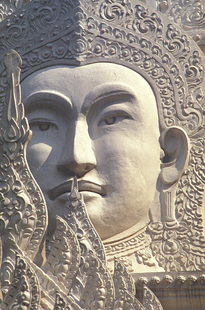 Thailand, Bangkok, Wat Rachapradit, closeup of stone Buddha image.