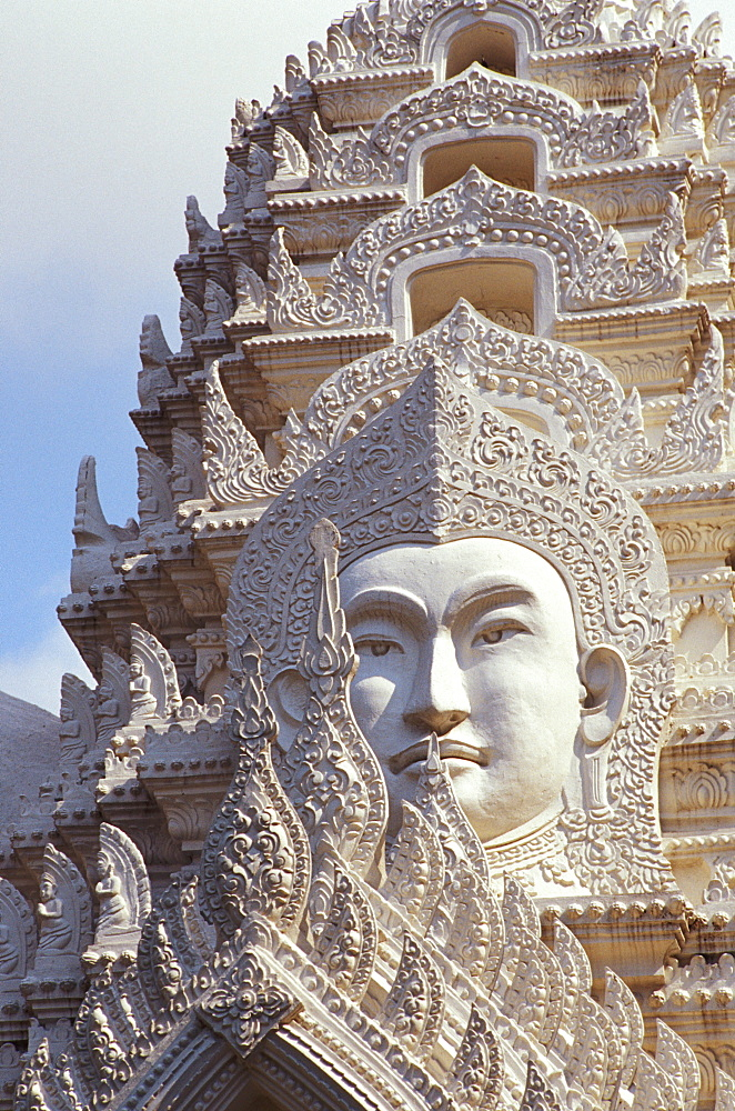 Thailand, Bangkok, Wat Ratchapradt, Buddha Image on ornate stone temple.