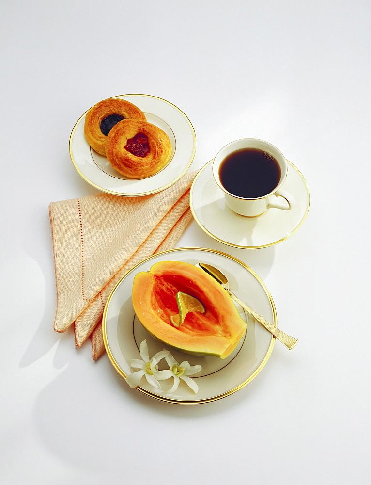 Continental breakfast, papaya, coffee, rolls