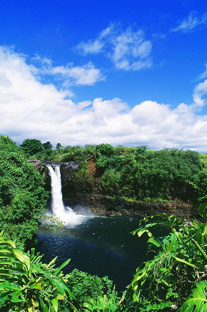 Hawaii, Big Island, Hilo, Wailuku River State Park, Rainbow Falls, Rainbow in mist of waterfall.