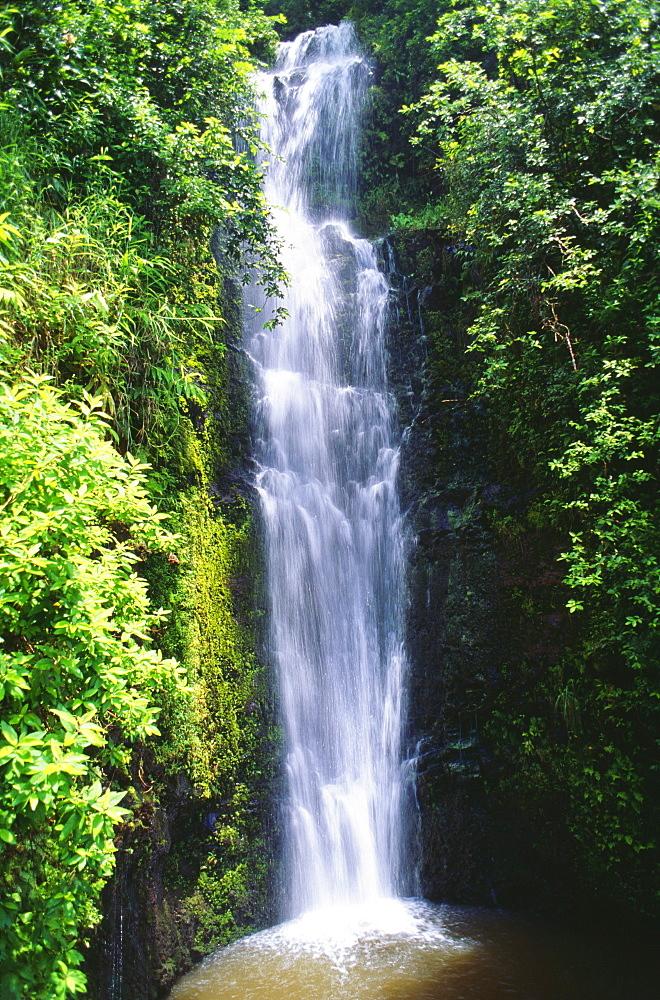 Hawaii, Maui, Hana, Wailua Falls valley, Waterfall surrounded by lush greenery