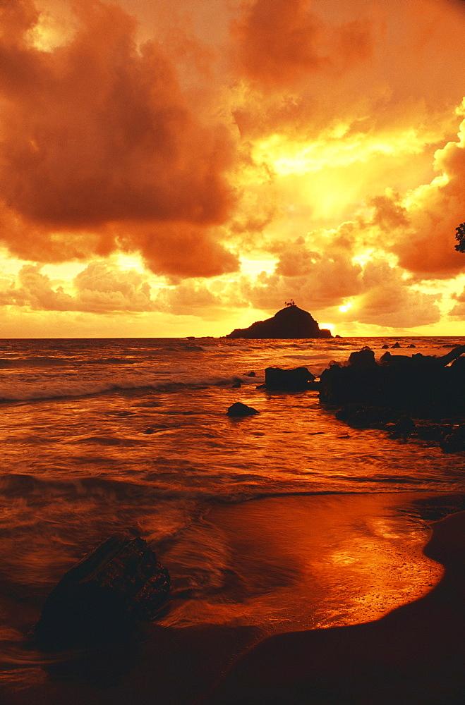 Hawaii, Maui, Hana, Gorgeous orange and yellow sunrise over the ocean