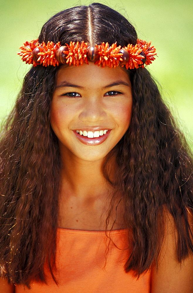 Young Hawaiian girl with orange haku.