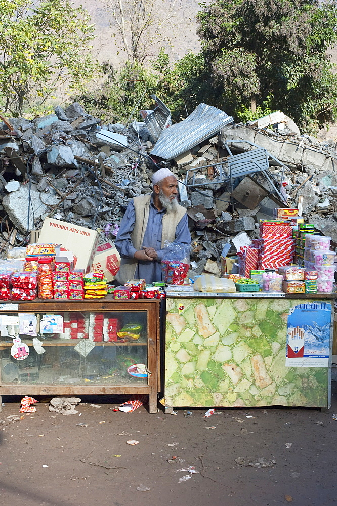 Man At His Shop In Front Of The Bazaar Destroyed By The 8 October 2005 Earthquake, Chinari, Azad Kashmir, Pakistan