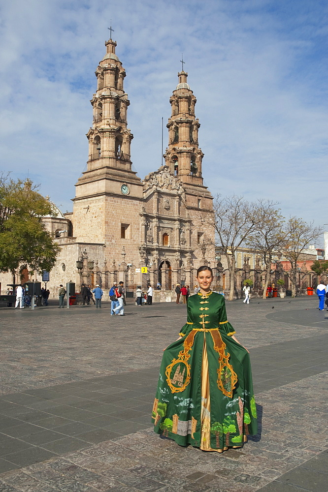 Young Woman In A Traditional Dress On La Patria Square In Front Of The Basilica Cathedral, Aguascalientes, Mexico