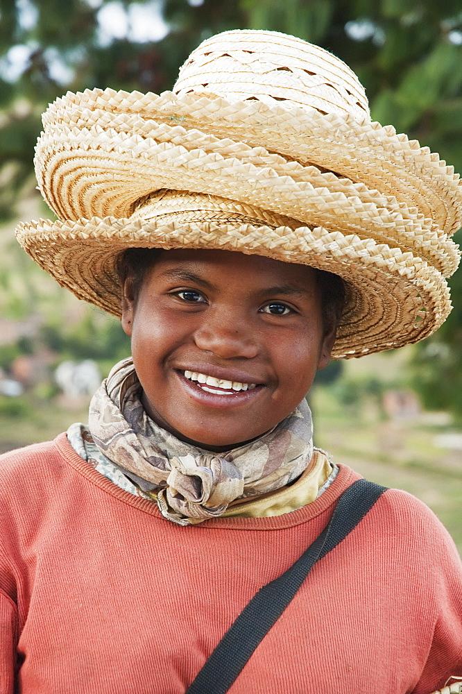 Girl Selling Hats In Tritiva, Antananarivo Province, Madagascar