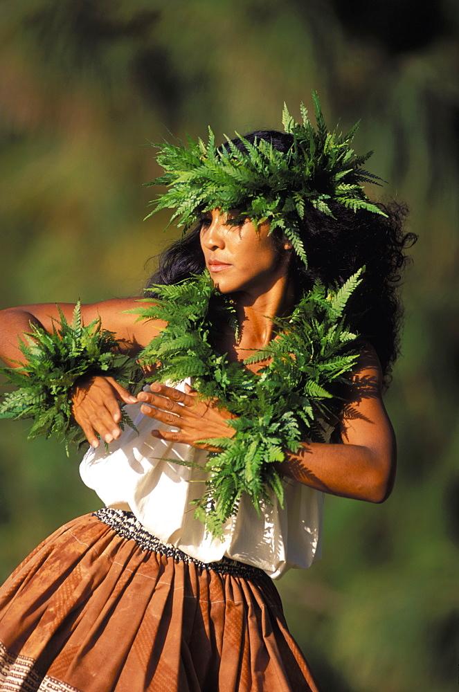 Hawaii, Outdoor Front Angle Of Woman Dancing Hula, Wearing Fern Haku, Lei And Kupe'e Blurry Background - 1116-39216
