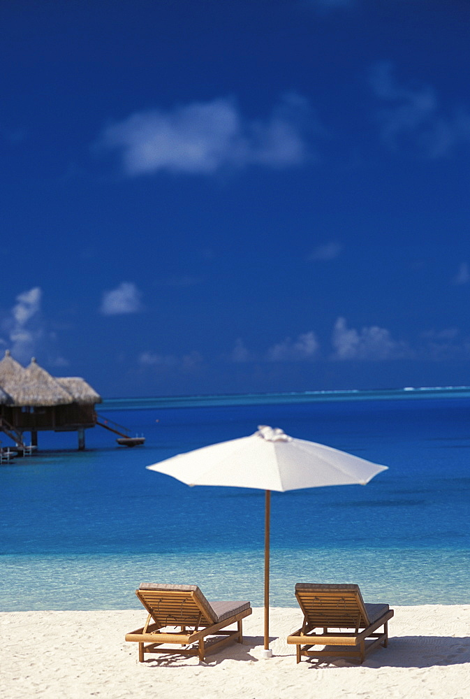 French Polynesia, Bora Bora, Chairs And Umbrella On Deserted Beach, Blue Sky, Water, White Sand