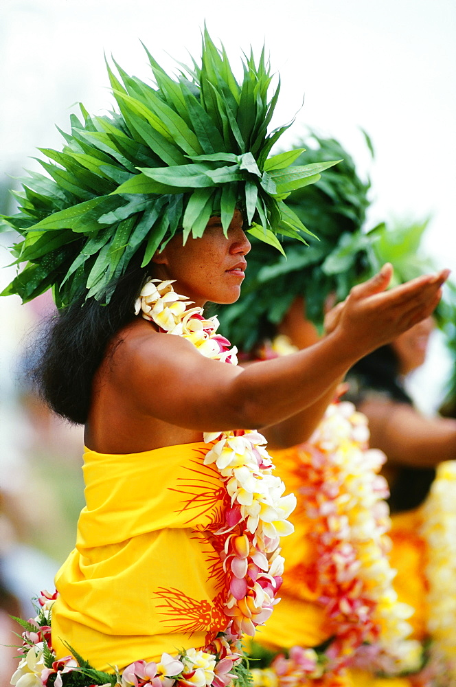 French Polynesia, Bor Bora, Tahitian Dancers In Native Costume, Green Plant Headresses.